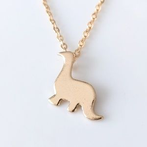 Jewelry - Adorable gold-plated dinosaur pendant necklace